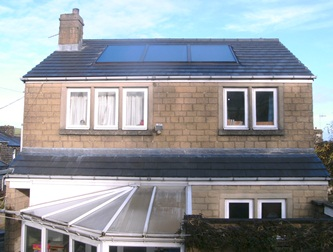 Solar panels help to improve the energy efficiency of this detached house