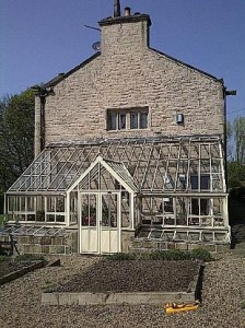 A completed greenhouse added to a listed building